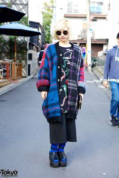We see Matsuri around the streets of #Harajuku several times a week as she works at the hip boutique Honey's Dead. Her style here includes a cool plaid coat and studded Tokyo Bopper platforms. Check all of Matsuri's snaps here! #tokyofashion #streetsnaps