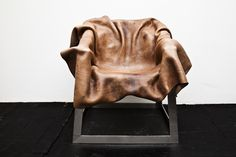 leather draped over metal chair