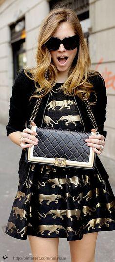 Gold and black print dress & black jacket with gold trim & Chanel black and gold bag
