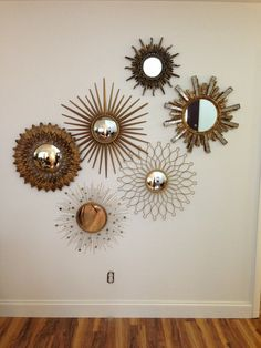 ::Ideas for Creative Decorating the Walls:: Love this cluster. Though wall space in our home tends to go to stacks and shelves of books.