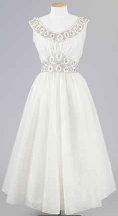 Debutante dress embellished with hand beading [front view], 1950s. Nylon. New Zealand Fashion Museum. Credit: Courtesy of Phillippa Freeman.