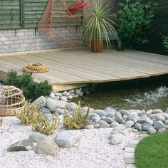 Nautical garden pond with beach style edging