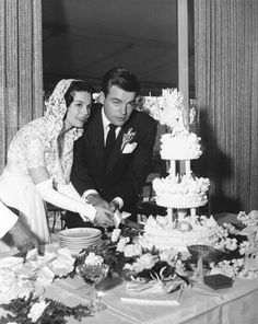Actress Natalie Wood and actor Robert Wagner cut their wedding cake after their wedding in Scottsdale, Ariz., on Dec. 28, 1957. They divorced six years later and remarried in 1972.