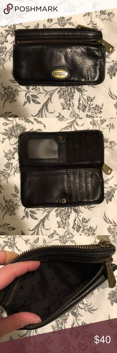 Fossil explorer wallet In great condition! I just don't use it anymore. Clean inside and out. Fits an iPhone 8 comfortably in the largest zip pocket. It's a great little clutch wallet! With plenty of room! Matches the fossil explorer crossbody purse also in my closet! Fossil Bags Wallets