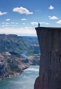 Preikestolen, also known as Pulpit Rock, just outside of Stavanger, Norway. Base jumpers often leap off this massive cliff towards the Fjord below. Places Around The World, Oh The Places You'll Go, Places To Travel, Places To Visit, Travel Stuff, Travel Destinations, Dream Vacations, Vacation Spots, Beau Site
