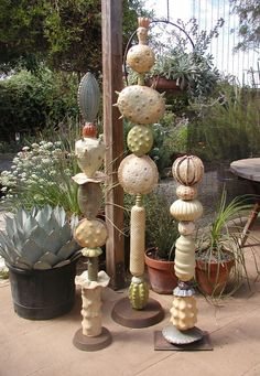 Image result for Artist Dave Borchers creates 6-7 foot tall mixed media sculpture that combine found art-glass from the 1920's-1970's, with meta
