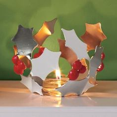 Modern Holly Tealight Holder - Holly leaves are crafted from highly polished metal for a merry mirrored shine. Display with an Escential or GloLite jar or pillar candle, sold separately, for the perfect holiday centerpiece. Modern Christmas Decor, Modern Decor, Christmas Decorations, Scented Candles, Pillar Candles, Candles Online, Holiday Centerpieces, Holly Leaf, Beautiful Candles