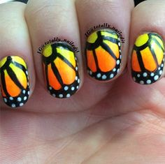 Fly away with this butterfly nail art.