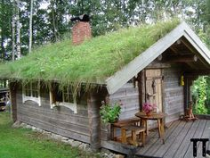 """Pretty Swedish """"Stuga"""" in Lilla Edet Municipality, Västra Götaland County, Sweden / The Green life How cute is this cabin. Green roof, fire place, little all wood."""