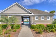 Community amenity center.  Heron Bay at Barefoot - Golf Condo Townhomes for Sale.  #heronbay  http://www.barefootrealty.com/heron-bay-townhomes/