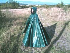 Well protected in a lovely long green rubber cape Capes & Ponchos, Rain Cape, Green Raincoat, Vinyl Raincoat, Rubber Raincoats, Pvc Coat, Rain Wear, Girls In Love, Girls Wear