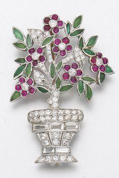 PLATINUM, DIAMOND, RUBY AND HARDSTONE BROOCH, CIRCA 1925