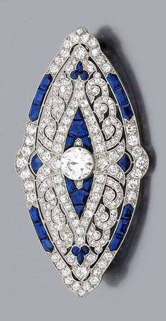 A diamond, sapphire and platinum Art D�co brooch by Mauboussin 1924