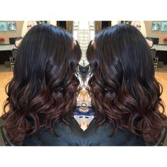 Dark brunette black hair with red balayage ombre ends on medium long hair