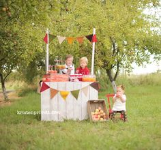 MUST make this booth! Can have change out signs for different families/seasons. Chalkboard sign maybe?