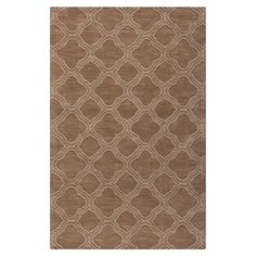 Loomed wool rug with a brown quatrefoil motif. Handcrafted in India.  Product: RugConstruction Material: Wool