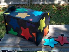 wooden toy box with glow in dark paint. ....i like the glow in the dark paint idea!