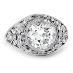 Art Nouveau reproduction ring with old European cut diamond in a platinum bezel setting with 38 single cut diamonds in the floral-inspired gallery; 2.53tcw
