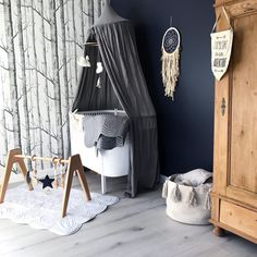 Scandi nursery perfection with that amazing forest woodland wallpaper and the heirloom quality wooden play gym from Modern Monty featured. Such amazing nursery inspiration!