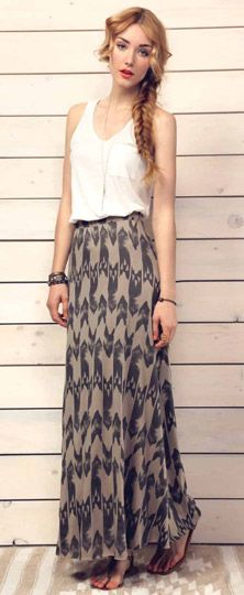 Pinner said: Floor length skirts are a perfect way to dress up, while still being modest and not showing too much skin. This navy and tan skirt goes perfectly with this white tank and brown flip flops for the summer. In the winter, simply add a navy quarter sleeve, long sweater, some brown combat boots and a scarf with a tan print, and the outfit is transformed into something totally different.