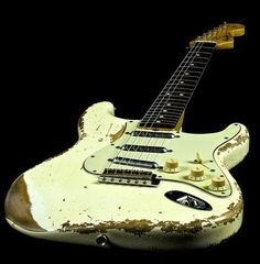 """This white (more unusual color, by the way) """"Slightly Used"""" Fender Stratocaster obviously has brought a guitarist many hours and years of joy in music! -DdO:)"""