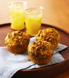 These muffins have it all--nuts, raisins, and spices wrapped in a flavorful cake with a crunchy nut topping. If you like, substitute canned pumpkin (not pumpkin pie mix) for the sweet potato.