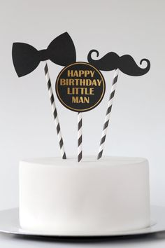An adorable set of three cake toppers with a Little Man theme.  Trio includes 1 Mustache, 1 Bowtie, and 1 disk with HAPPY BIRTHDAY LITTLE MAN in