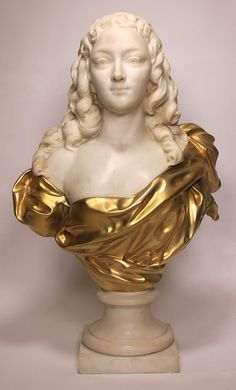 A Very Fine and Impressive 19th/20th Century Life-Size White Marble and Gilt-Bronze Bust of a Young Iris, Attributed to Henri Weigele (French, 1858-1927). The beautifully carved and sensual marble bust of a young Iris, which in Greek mythology is the personification of the rainbow and messenger of the gods, posing with a direct gaze and curly hair, her dress is depicted in gilt-bronze. Raised on a contemporary veined-grey marble pedestal. Circa: Paris, 1890-1900.
