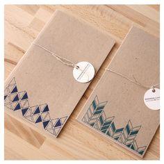 geometric patterned notebooks.