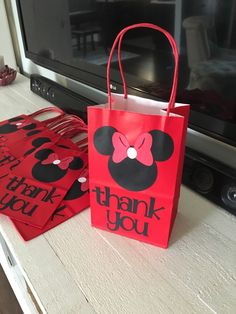 Red Minnie Mouse party favor thank you bags 12bags by MrsCustomCreations on Etsy https://www.etsy.com/listing/263978702/red-minnie-mouse-party-favor-thank-you