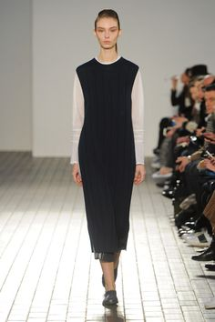 "The 1205 Fall 2015 Ready to Wear was full of tailored knits and was very minimalistic. In this one ensemble in particular I recognized a early classic ""Chanel"" look which was wool jersey day dress. The garment in this collection is a knit dress that has the same silhouette as a Chanel dress from the mid 1920's. Even the shoes worn on the model are similar to the shoes worn during that time period. 4/6/15"