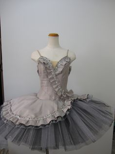 """New creation 2015/2016 """"Moonlight"""" is a professional tutu featuring an amazing shade of """"moonlight"""" grey. It can be used for many classical variations. The bodice is made with shiny silver/grey silk t"""