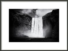 Framed Fine Art Print: Skogafoss waterfall in Iceland, black and white artwork with stark contrast. Skogafoss is one of the biggest waterfalls in Iceland. It has a width of 25 metres (82 feet) and a drop of 60 m (200 ft). Lots of different image sizes and frames available, every purchase comes with a 30 days money back guarantee. (c) Matthias Hauser hauserfoto.com
