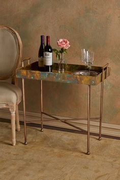 Cooper Tray Table is made of solid wood and covered with beautiful mottled oxidized copper.