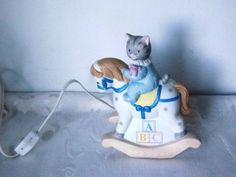 Porcelain Kitty Cucumber Cat w Doll Setting on A Rocking Horse Night Light 1989 | eBay