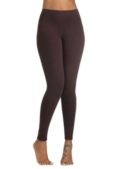 Simple and Sleek Leggings in Mocha. Every fashionista knows that her wardrobe isnt complete without a bevy of versatile basics - thats why these brown leggings are always making their way into your daily ensembles! #brown #modcloth