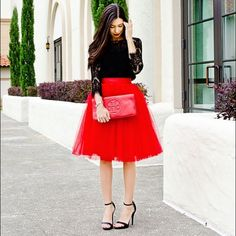 Gorgeous Red Tulle Tutu Midi Skirt If Carrie Bradshaw can rock a tutu in NYC, you can rock one anywhere. This gorgeous non-stretchy skirt has 6 layers of semi-sheer tulle, satin lining and features an elasticized waistband for a ballerina inspired Hand wash cold, hang dry. Do not bleach Handmade Skirts