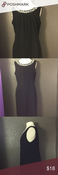 Black Cocktail Dress with Peal Beaded Coller Dress has pockets. Hasn't been worn practically brand-new. Dresses Midi
