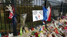 Feelings up against the wall - This is a mobile phone photo of the French Embassy in Ottawa, ON, CAN a couple of days after the terror activities in Paris. The flowers, notes etc. were beautiful to see showing the outpouring of love from people paying respects. Nov 18 2015 Gary Corcoran Arts https://twitter.com/garycorcoranart