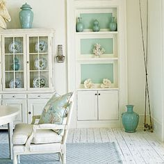 What a little pop of color does to simple shelves!  Love this room, it reminds me of our 1878 adobe farmhouse we used to own - wear, tear, character and charm that is very comfortable for guests.