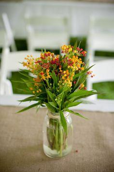 backyard minnesota wedding, yellow and red and green flowers, mason jar, burlap, white chairs, tent, outdoor wedding, emma freeman photography, minneapolis wedding photographer