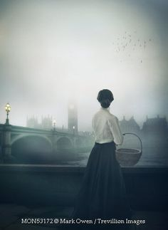 Trevillion Images - historical-woman-in-london-at-night