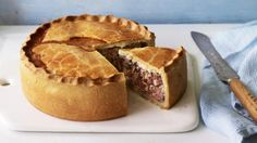 A game pie always makes a spectacular centrepiece and this handsome example is amazingly straightforward to make – especially if you buy mixed game meat ready-prepared from a good butcher.  Equipment and preparation: you will need a 20cm/8in spring-form cake tin, about 7cm/2¾in deep.