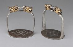 Pair of stirrups, 16th–18th century Tibetan Iron, gold, and silver; H. 5 1/8 in. (13 cm) Purchase, Rogers Fund and Bequest of Stephen V. Grancsay, by exchange, 1997 (1997.214.2a,b)
