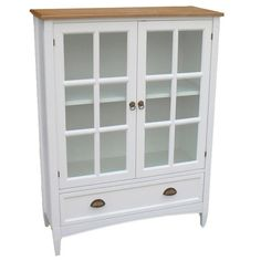 Birch wood bookcase with an adjustable shelf and paned glass doors.   Product: BookcaseConstruction Material: Birch ...