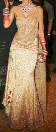 Indian bride wearing beautiful gold reception gown