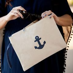 New! Our Preppy Anchor Monogrammed Canvas Accessories and Cosmetics Pouch is the ideal nautical themed zip pouch to help organize the necessities for the beach, pool or every day. This zipper bag holds everything from makeup to sunglasses and a swimsuit or an iPad! The handy wrist strap makes this a versatile little take-a-long.  www.beaujax.com