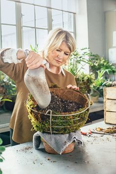 Add potting mix, leaving room for the plants (so it's about two-thirds full). We use a blend especially made for containers that includes perlite, peat moss, vermiculite, and sand.