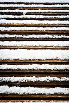 Horizontal Lines, snow on a wood table