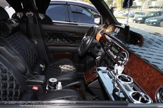 Scion XB VIP Interior....don't know why one would need all those cup holders,  but loving the custom leather.